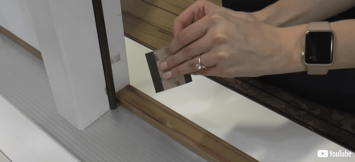 Removing the backing from a corner pad.